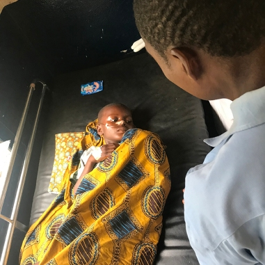 A 7 year old boy who had cerebral malaria. He was brought from a long distance, and had been in a coma for 7 days. He just woke up yesterday!